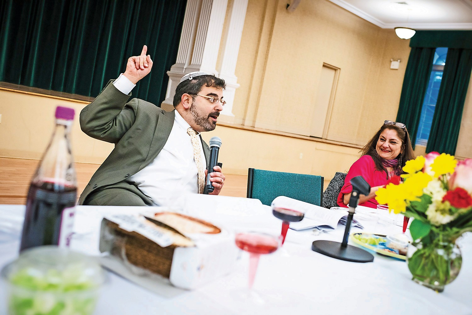 Rabbi Asher Lopatin speaks at a seder celebration at Manhattan College in 2015. Rabbi Lopatin announced that he will step down as president of the school at the end of July.