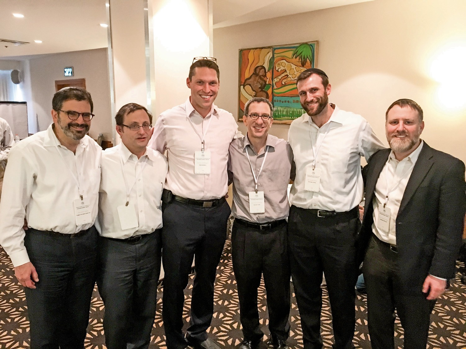 Rabbi Asher Loptain, left, attends a conference with other rabbis in Israel. Rabbi Lopatin is the president of the Yeshivat Chovevei Torah Rabbinical School, and will step down from the position in July.