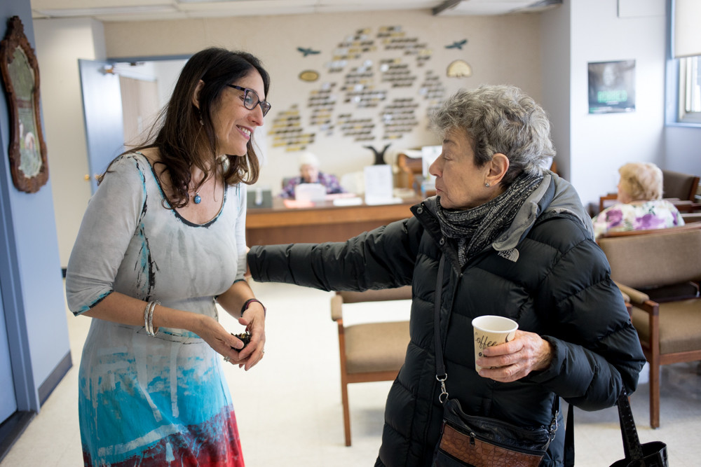 Julia Schwartz-Leeper, left, the outgoing executive director of Riverdale Senior Services, talks with Judith Kramer, who served as president of the RSS board for three years. Schwartz-Leeper, who led RSS for 12 years, leaves at the end of the month.