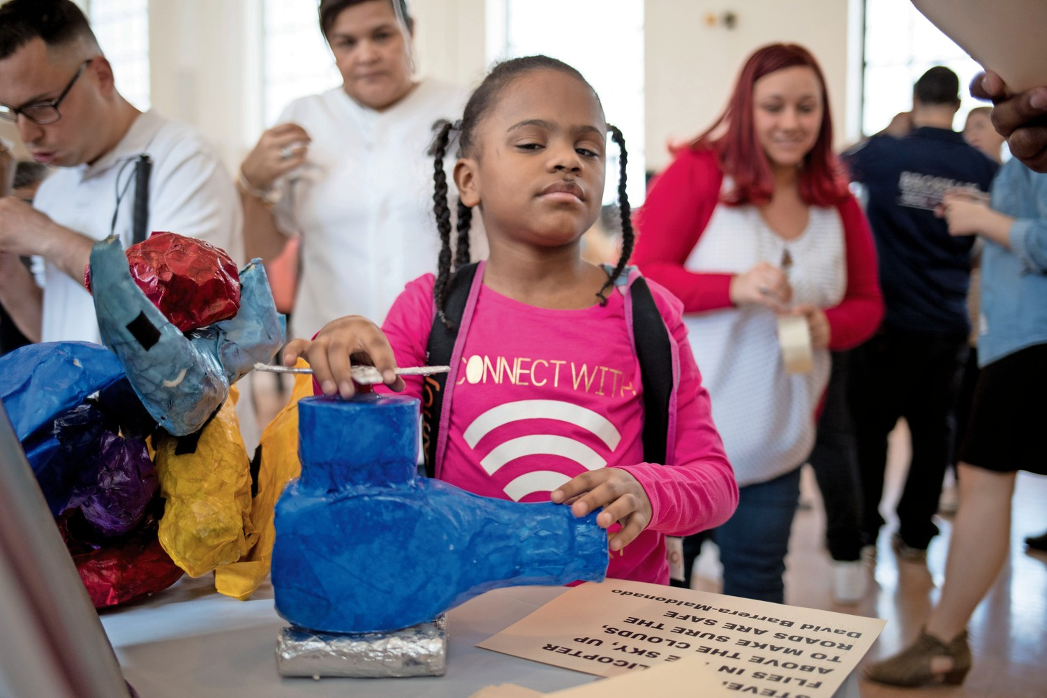 Janicesa Rodriguez, a fourth grader at Lavelle School for the Blind, feels a sculpture at the school's third annual art exhibit.