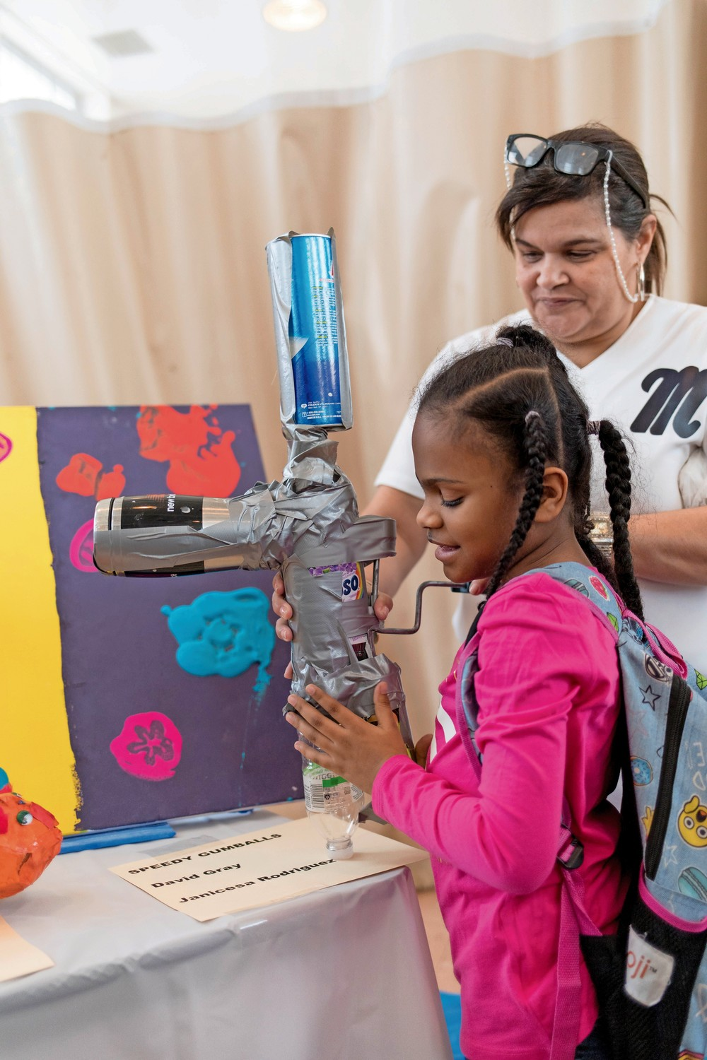Janicesa Rodriguez, a fourth grader at Lavelle School for the Blind, holds a sculpture representing her baby cousin, which she made for the school's third annual art exhibit.