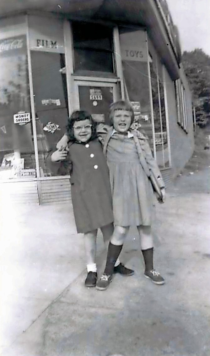 A young Debbie Eiseman, left, stands with a friend outside of her father's restaurant, Jimmy's Luncheonette, on the corner of West 259th Street and Riverdale Avenue.