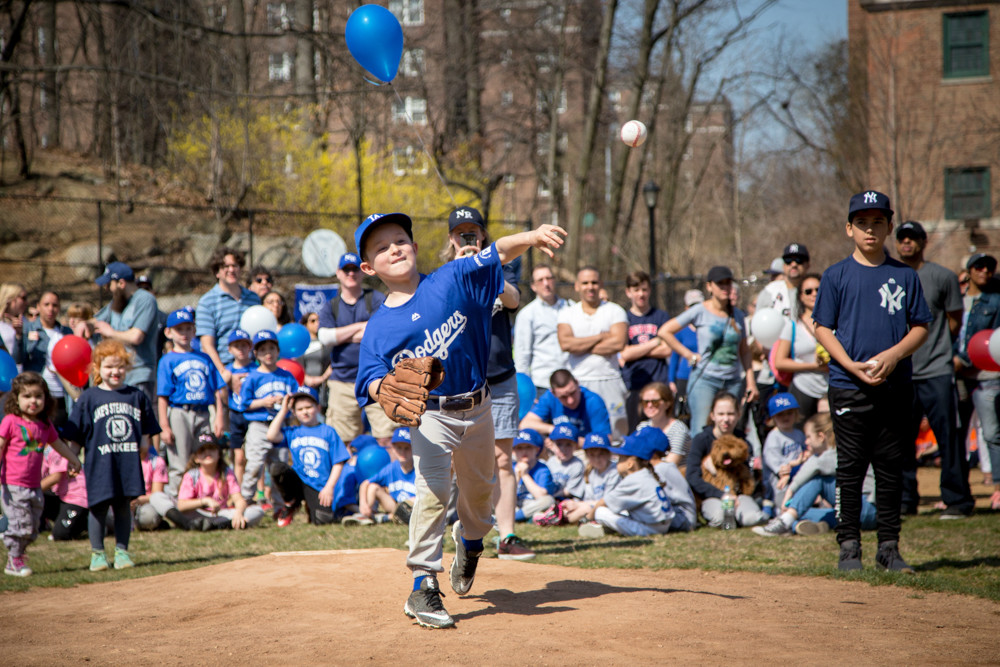 John Zarnitzky throws the first pitch of the North Riverdale Baseball League season at Sid Augarten Field this past weekend.