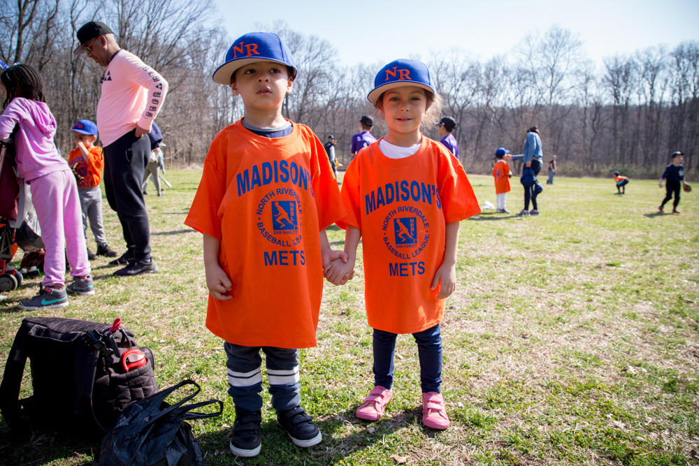 Dean Mercedes and Dylan Mercedes get ready to march in the North Riverdale Baseball League parade last weekend as baseball season officially gets under way.