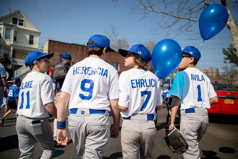 Little league players in the North Riverdale Baseball League marched in full uniform with balloons in hand to mark the start of the season last weekend.