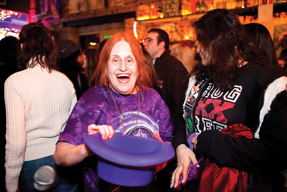 Ilene Richards collects donations for the Purple Hat Foundation during its fundraiser at An Beal Bocht Café in 2013. For the last eight years, Jeremy Bar-Illan has hosted this benefit concert to honor the memory of his 17-year-old son, Zachary Bar-Illan, who lost his battle with osteosarcoma, a rare form of bone cancer, in 2009.