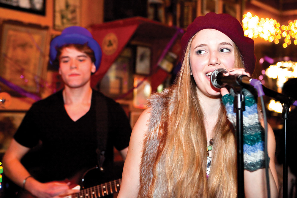 Julian Bar-Illan plays guitar and Sarah Halliday sings in the band Jeremy's Revolution during the Purple Hat Foundation fundraiser at An Beal Bocht Café in 2013. The next concert takes place April 21, and proceeds go to Musicians On Call, a nonprofit dedicated to bringing live and recorded music to hospital patients across the United States.