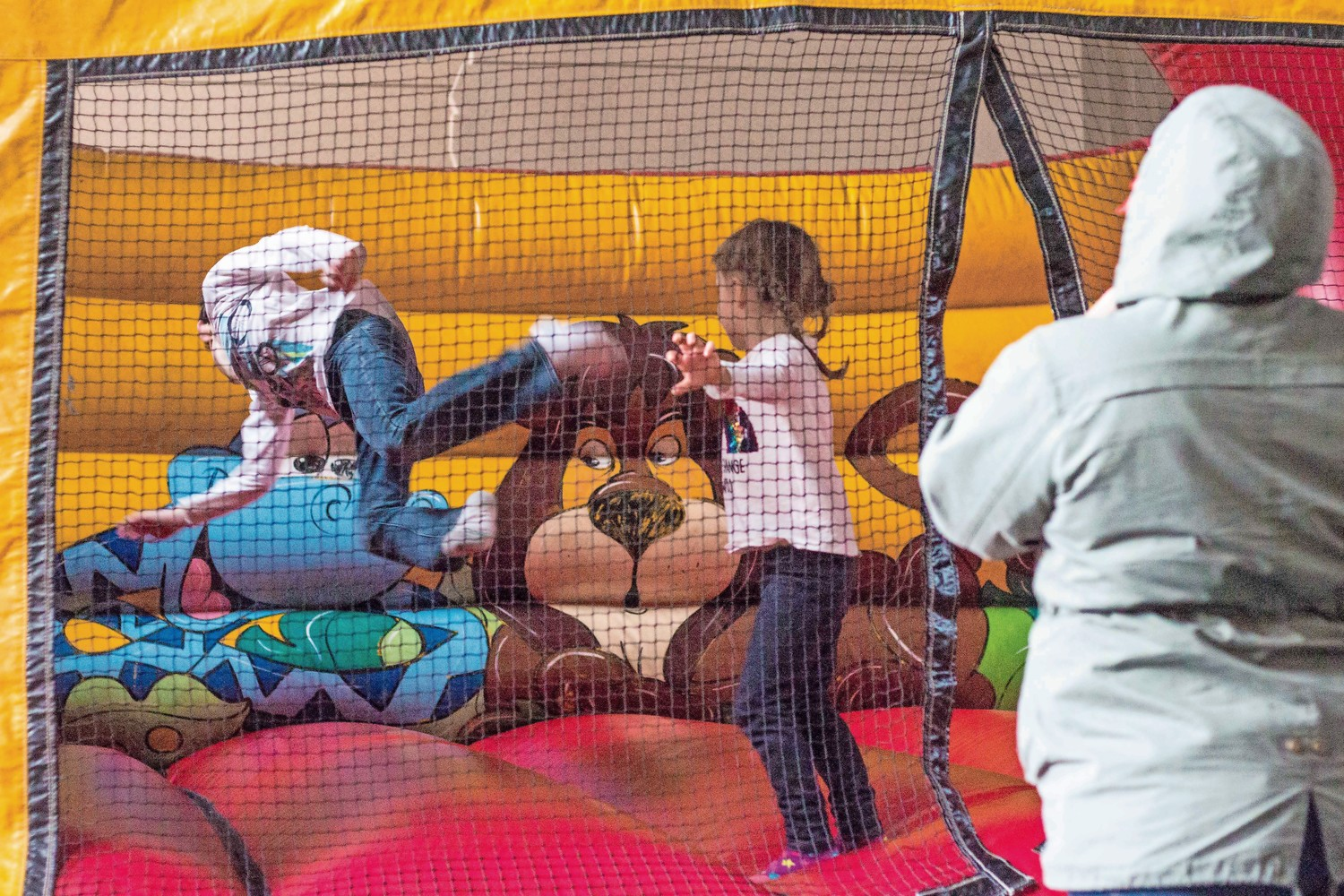 A young boy does a flip in a bounce house during the Bronx Israeli Independence Festival at the Hebrew Institute of Riverdale.