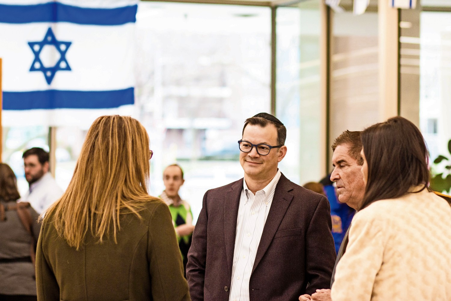 Councilman Andrew Cohen, center, and state Sen. Jeff Klein chat with attendees during the Bronx Israeli Independence Day Festival at the Hebrew Institute of Riverdale.