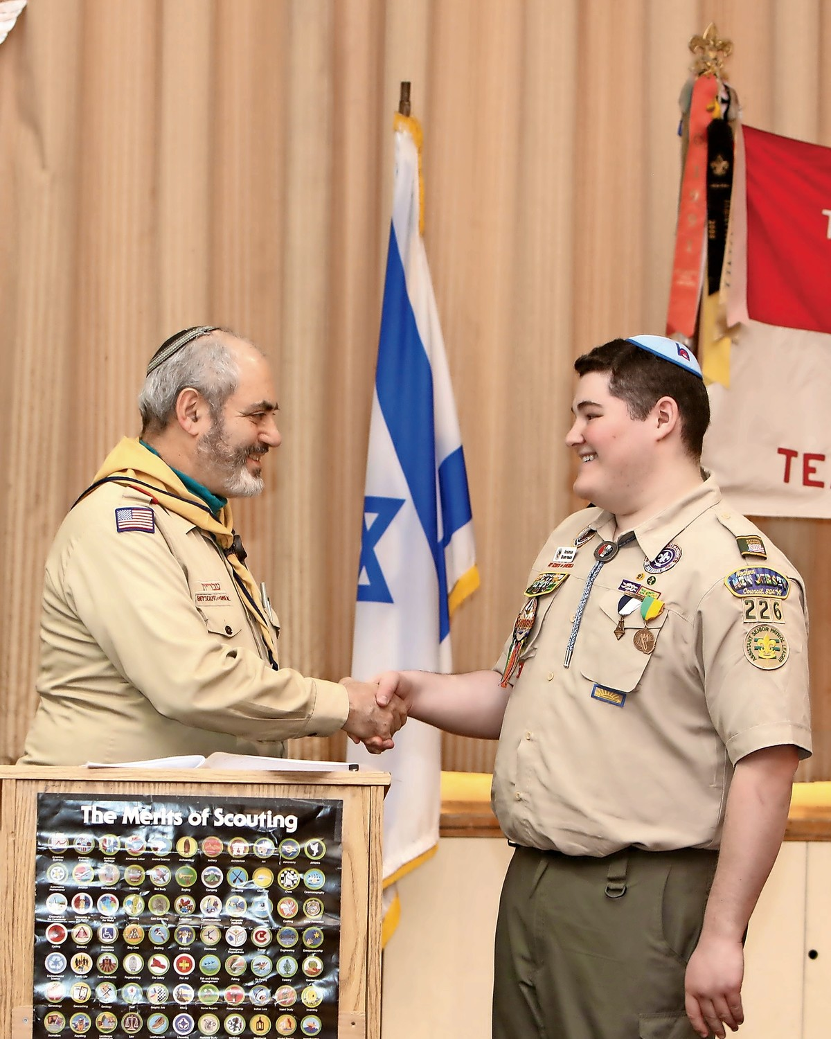 Joshua Dorfman, a new eagle scout, shakes the hand of assistant scout master Arvin Levine. Dorfman became an eagle scout on Feb. 25.