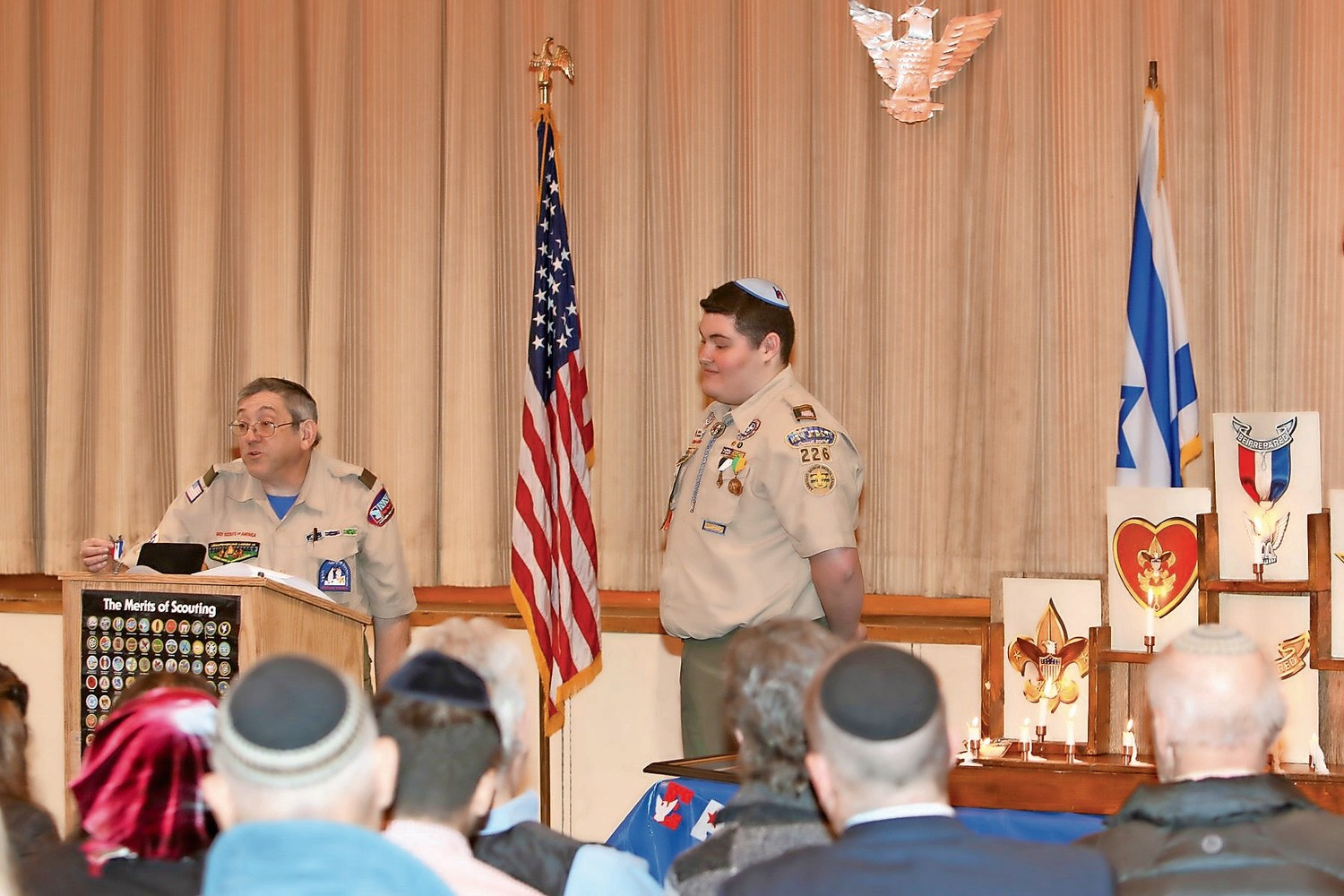 Danny Chazin, a scout master, speaks at Joshua Dorfman's eagle scout ceremony.