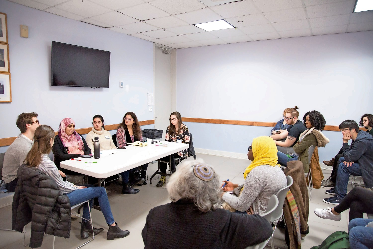 Rabea Ali, a Muslim student at Manhattan College, third from left, speaks at an interfaith event for Jewish and Muslim youth at the Riverdale Y.