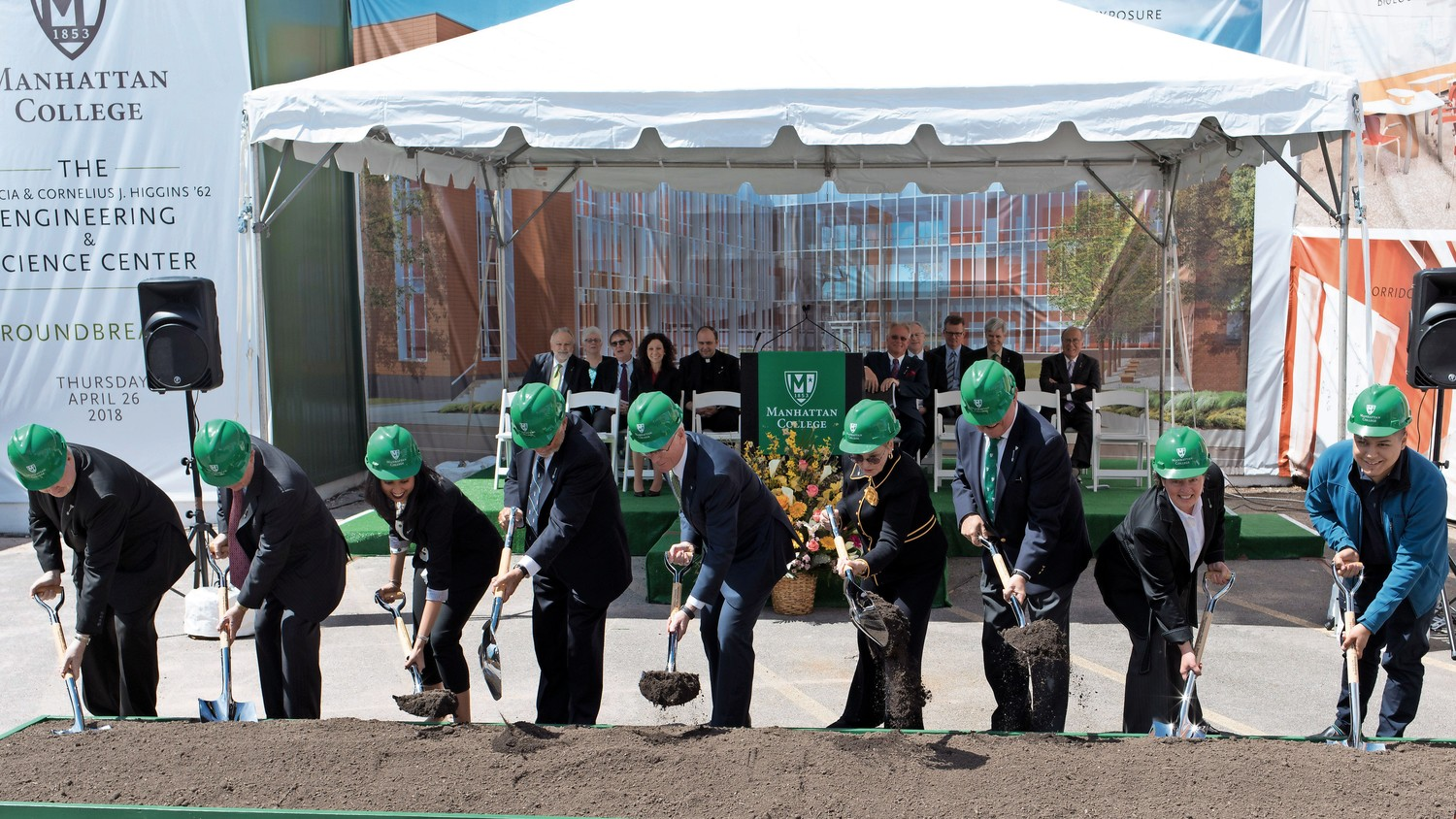 Manhattan College administrators, alumni and donors break ground by digging ceremonial soil at a groundbreaking ceremony for the Patricia and Cornelius J. Higgins '62 Engineering and Science Center. The new center is expected to be completed in 2020.
