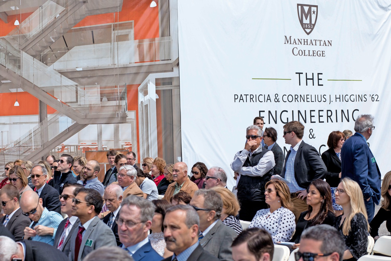 People take their seats at a groundbreaking ceremony for Manhattan College's Patricia & Cornelius J. Higgins '62 Engineering and Science Center. The new center is expected to be completed in 2020.