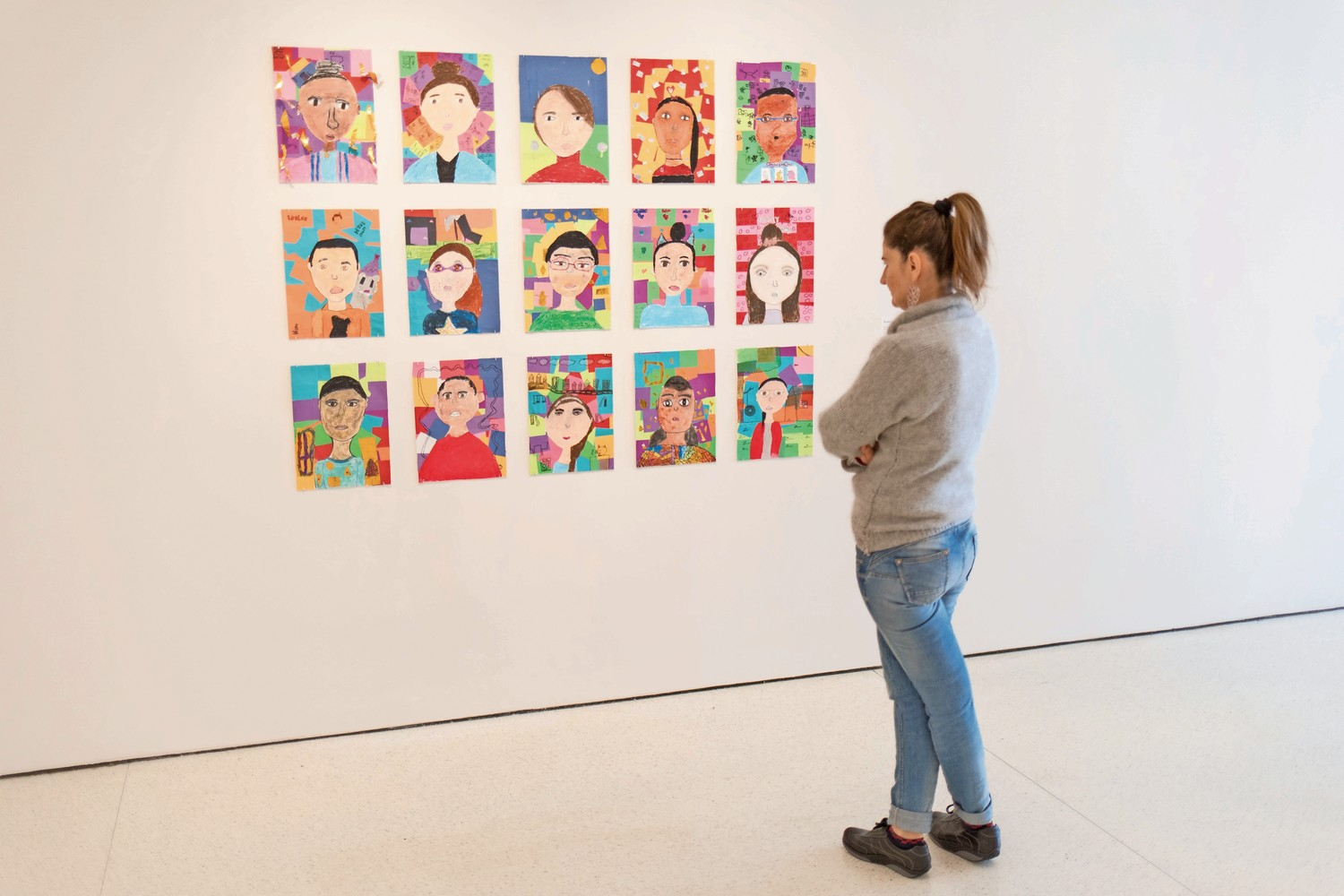 A visitor looks at 'Symbolic Self-Portraits' by fourth-grade students from P.S. 86 at the Guggenheim Museum.