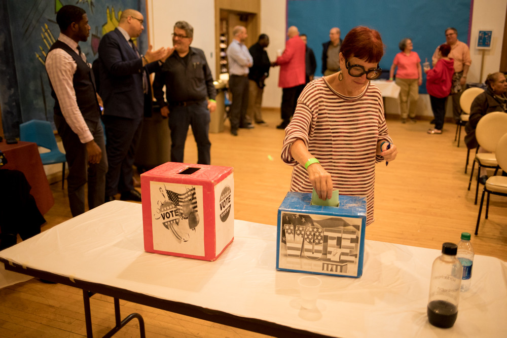 A member of the Benjamin Franklin Reform Democratic Club casts a ballot during an endorsement meeting held at the Riverdale Temple last week. It was a packed evening for club members as they considered state senate candidates for endorsement as well as the race for governor between Andrew Cuomo and Cynthia Nixon.