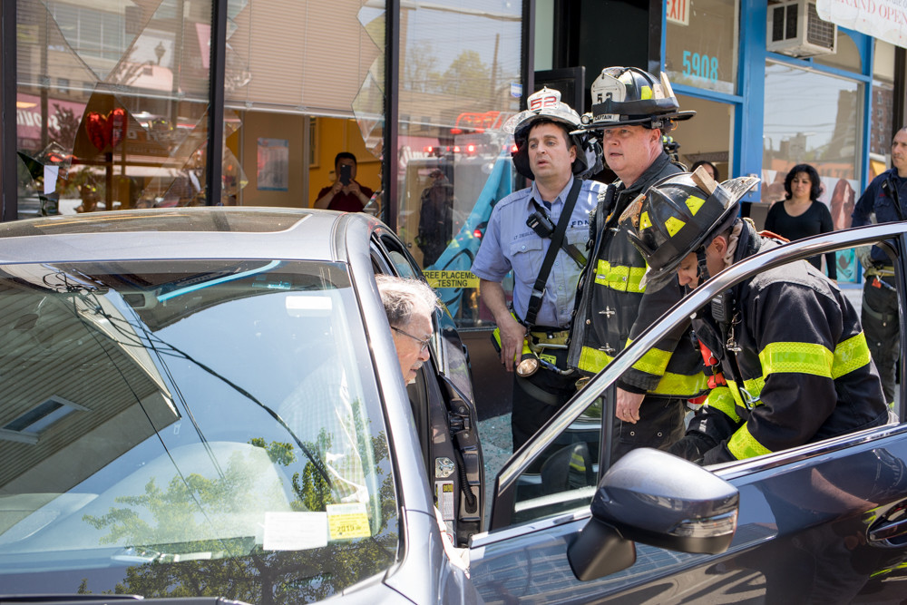 The fire department and police department respond to an accident where a car crashed into the Kumon Math and Reading Center's North Riverdale location.