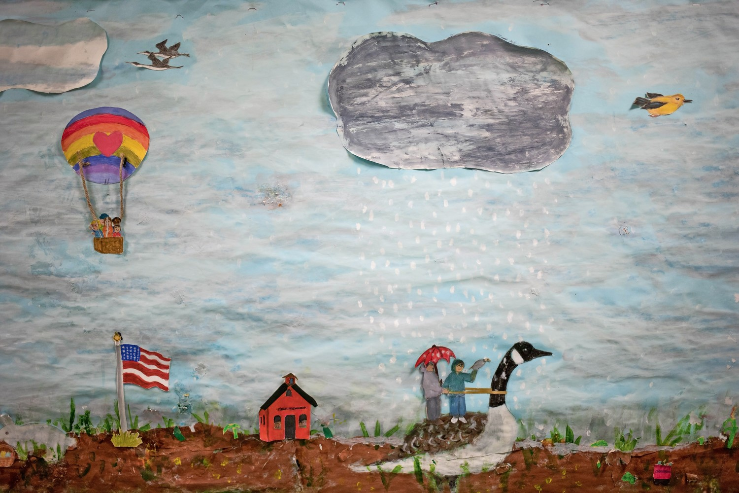 The latest mural at Amalgamated Nursery School is part collage and part painting.