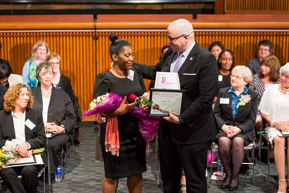 State Sen. Gustavo Rivera honored New York City Housing Authority resident Tiesha Jones for her efforts to improve quality of life at the Bailey Houses, where Jones serves as resident council president, at the senate's 20th annual Women of Distinction celebration in Albany on May 1.