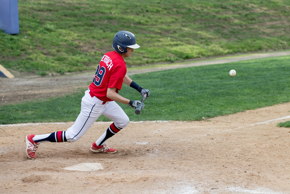 American Studies' first baseman Caleb Auerbach drops down a sacrifice bunt in the Senators' 3-2 loss to Columbus last week.