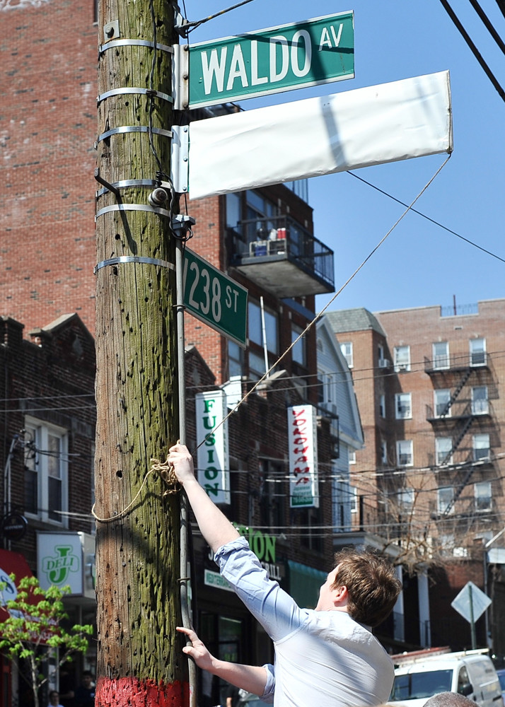 A new sign goes up at the intersection of West 238th Street and Waldo Avenue. The avenue has been ceremoniously co-named 'Andrew Sandler Way' to honor the former Community Board 7 district manager who died last year.