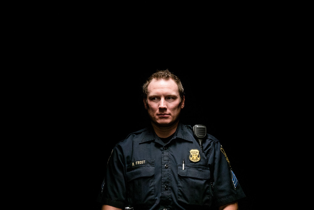 Sgt. Robert Frost has worked in Flint, Michigan, for more than 12 years, and has been fired and then rehired three times because of budget cutbacks. 'Flint is a Place' continues at the Bronx Documentary Center until May 27.