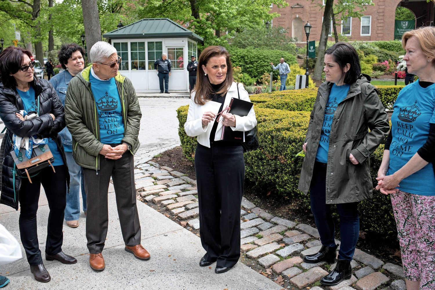 'I could your voice, and I was not alone,' said Ann Marie Flynn, a professor of chemical engineering at Manhattan College, after her preliminary termination hearing. Supporters gathered to protest Flynn's possible termination.