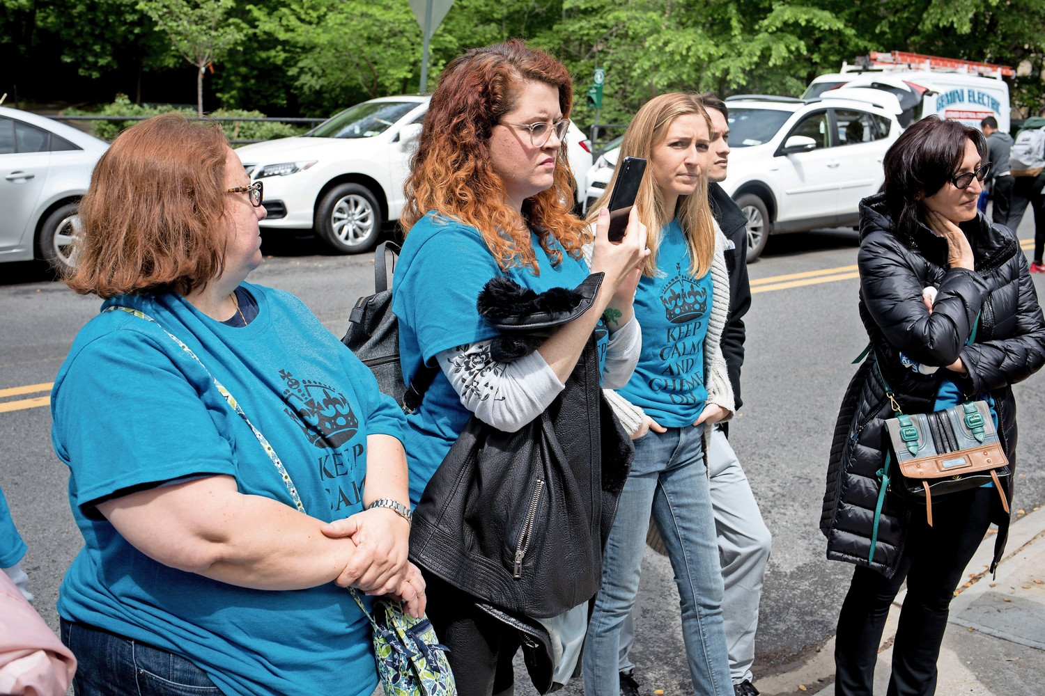 Morgan Brady films her aunt Ann Marie Flynn speaking to supporters outside of Manhattan College. A professor of chemical engineering, Flynn attended her preliminary termination hearing.