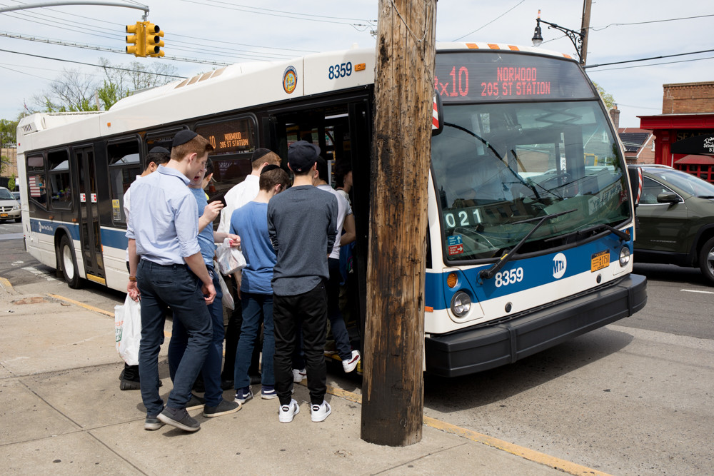 People board the Bx10 bus at West 259th Street and Riverdale Avenue. If Assemblyman Jeffrey Dinowitz has his way, MTA will add shuttles along the route between Riverdale Avenue at the city line, and West 231st and Broadway during peak ridership hours.