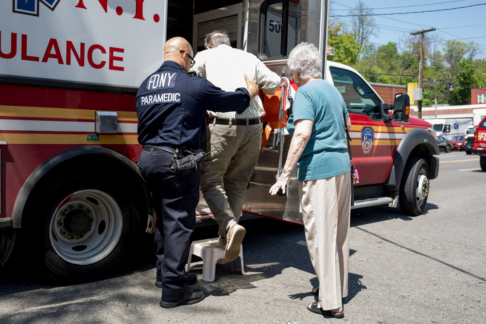 A paramedic helps the 82-year-old driver of a Subaru that plowed into the North Riverdale Kumon Math and Reading Center May 9 into an ambulance. The driver narrowly missed instructor Claire Kim, who said she'd stepped outside to check the mail right when the Subaru slammed into her storefront.