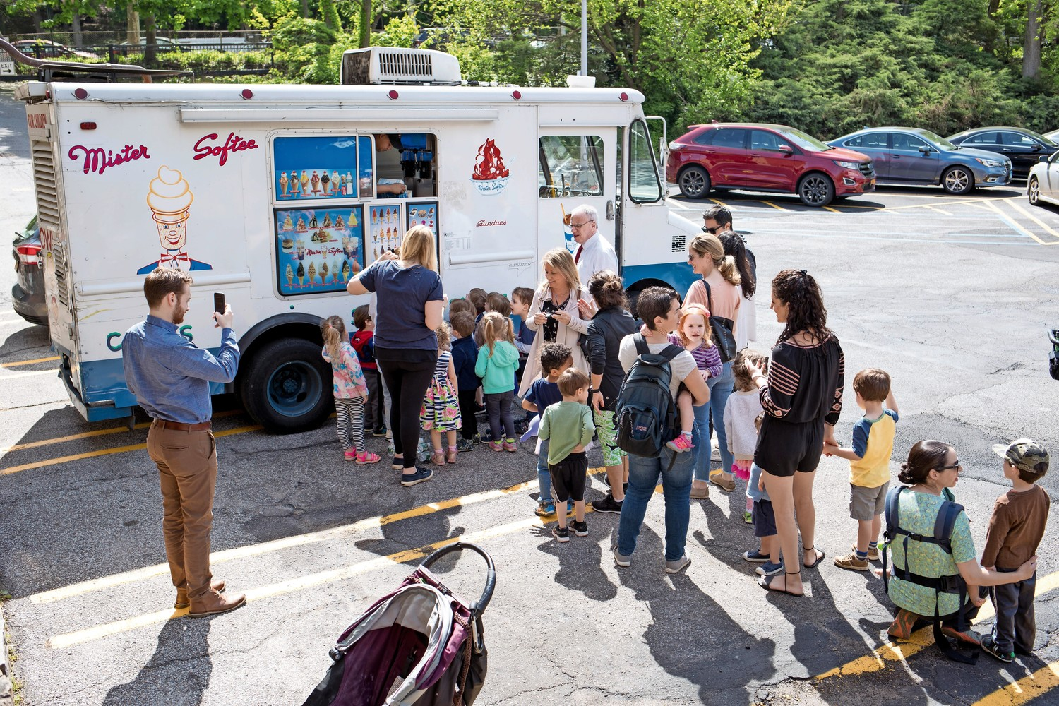 Kids line up for sweet treats at the Mister Softee truck during Truck Day at the Rivedale Temple.
