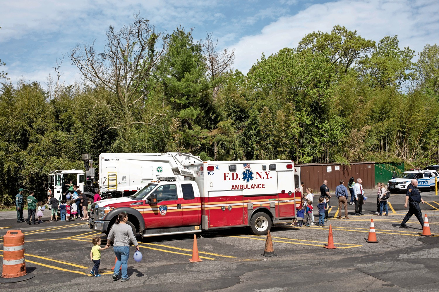 Truck Day brought together vehicles for kids to explore from different municipal agencies, including the fire, police and sanitation departments.
