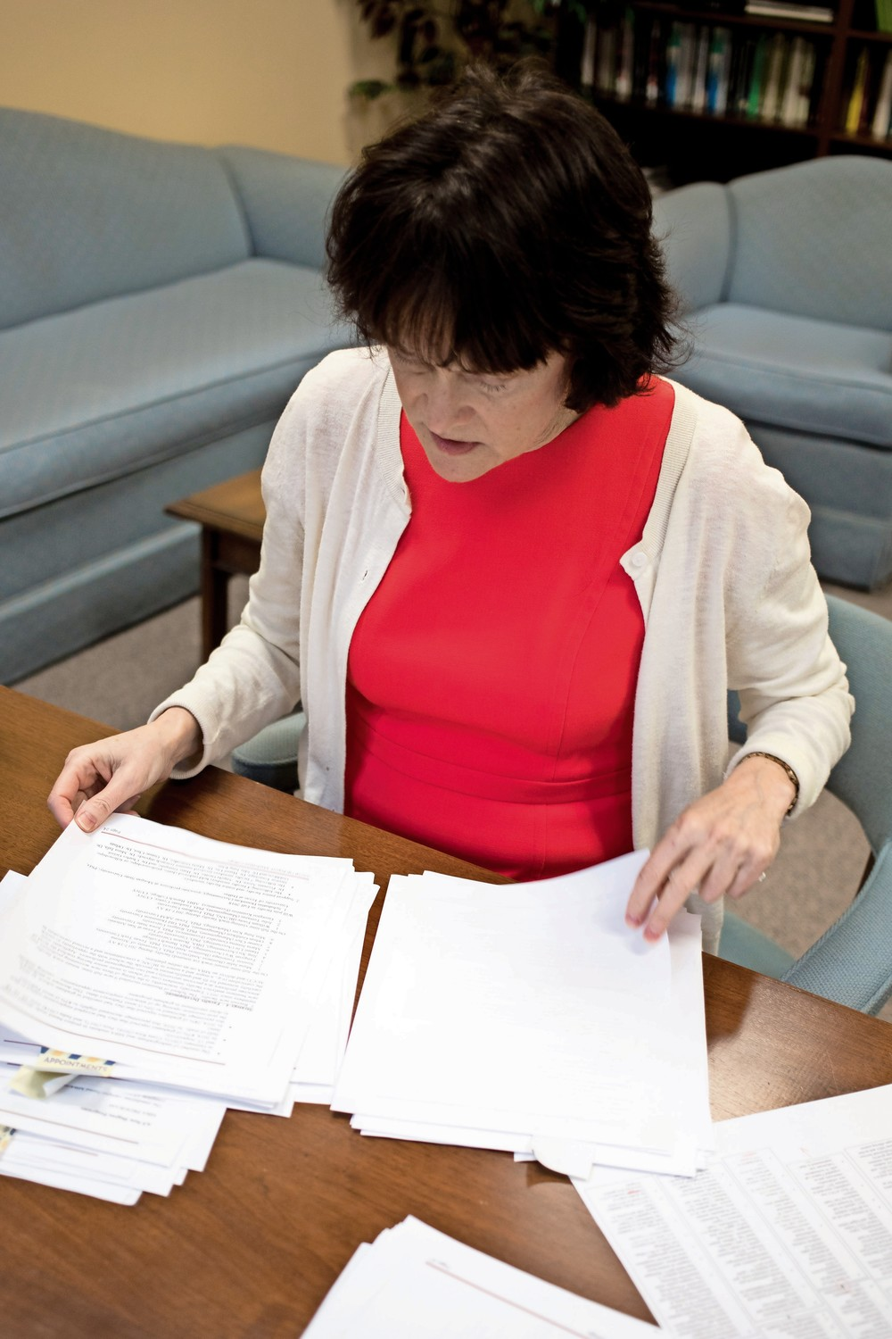 Janet Rovenpor, associate dean of Manhattan College?s School of Business, looks through paper work in a meeting with Aileen Farrelly, an assistant dean.