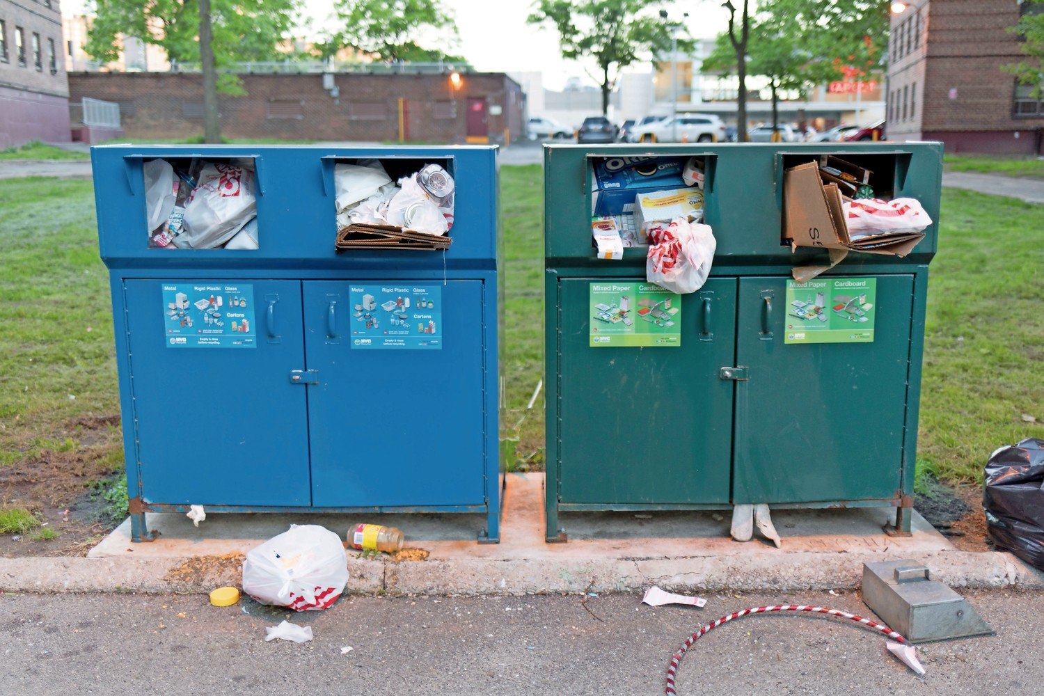 Garbage overflows from designated bins at Marble Hill Houses. The complex only has a handful of garbage bins, which is not enough for the number of buildings and tenants, according to Tony Edwards, the president of the Marble Hill tenants association.