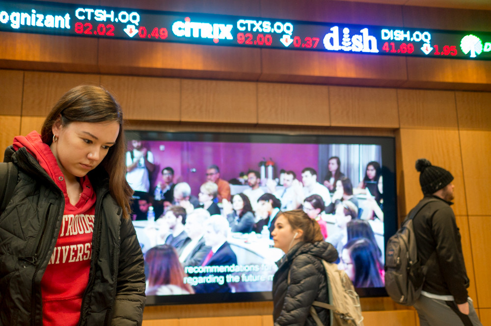 Manhattan College students walk by the stock ticker between classes at the O'Malley School of Business De La Salle Hall. The school gets a new dean in July — Don Gibson.
