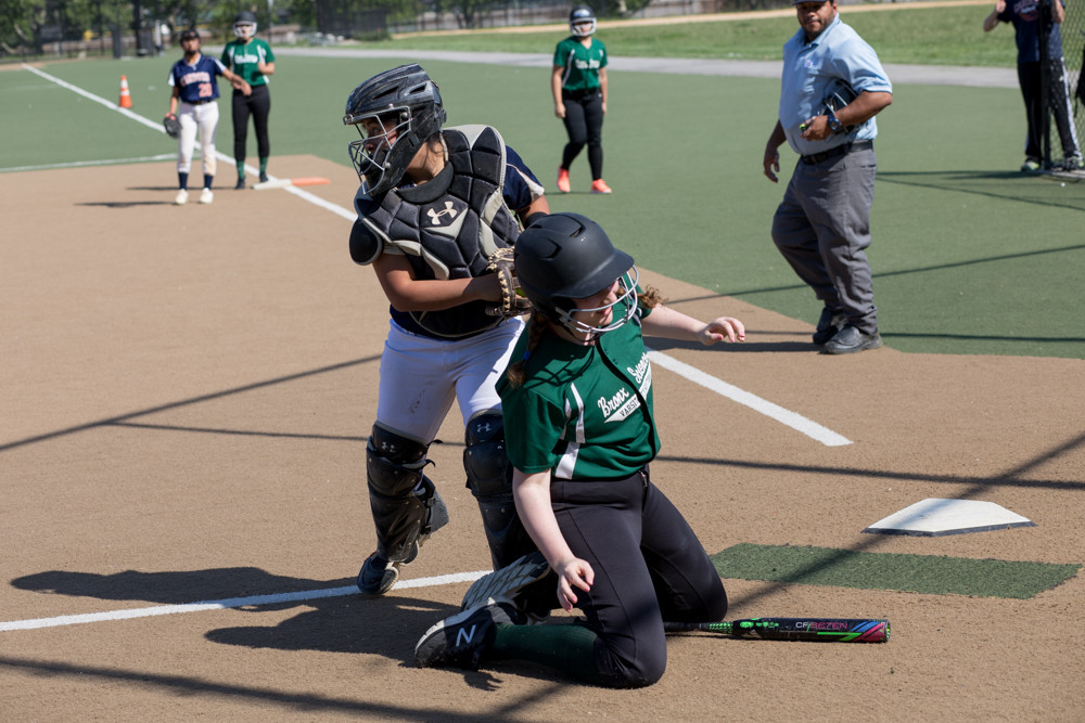 Bronx Science senior first baseman Fiona Sullivan is cut down at home after trying to tag up from third base in the first inning of the Wolverines' 8-7 victory over Cardozo.