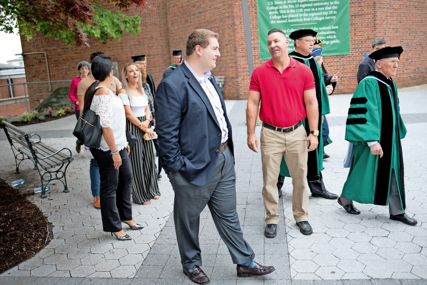 Ryan Quattromani, center, walks towards Draddy Gymnasium for the baccalaureate mass for graduating seniors at Manhattan College. Quattromani was recently honored by Councilman Andrew Cohen for his work with the Manhattan College Neighborhood Relations Committee, which he founded with Micaela Bishop, to forge a stronger relationship between students and the surrounding community.
