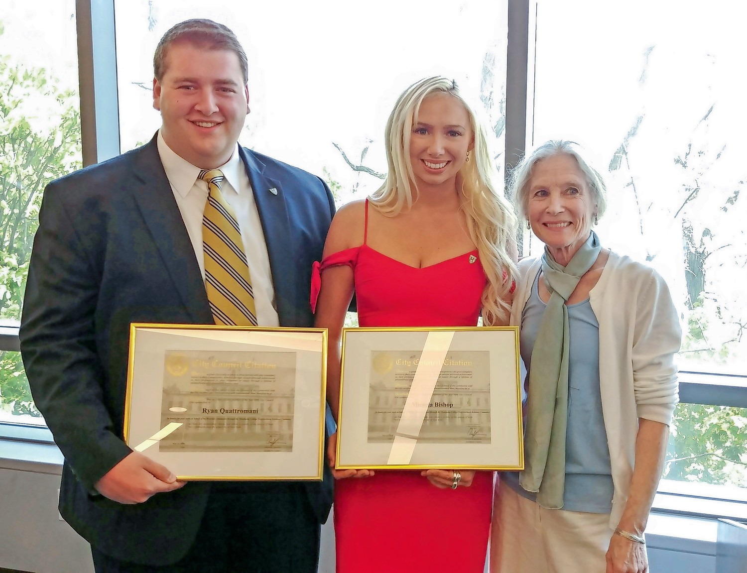 Ryan Quattromani and Micaela Bishop hold the citations they received from Councilman Andrew Cohen for their work forging stronger community ties through the Manhattan College Neighborhood Relations Committee.