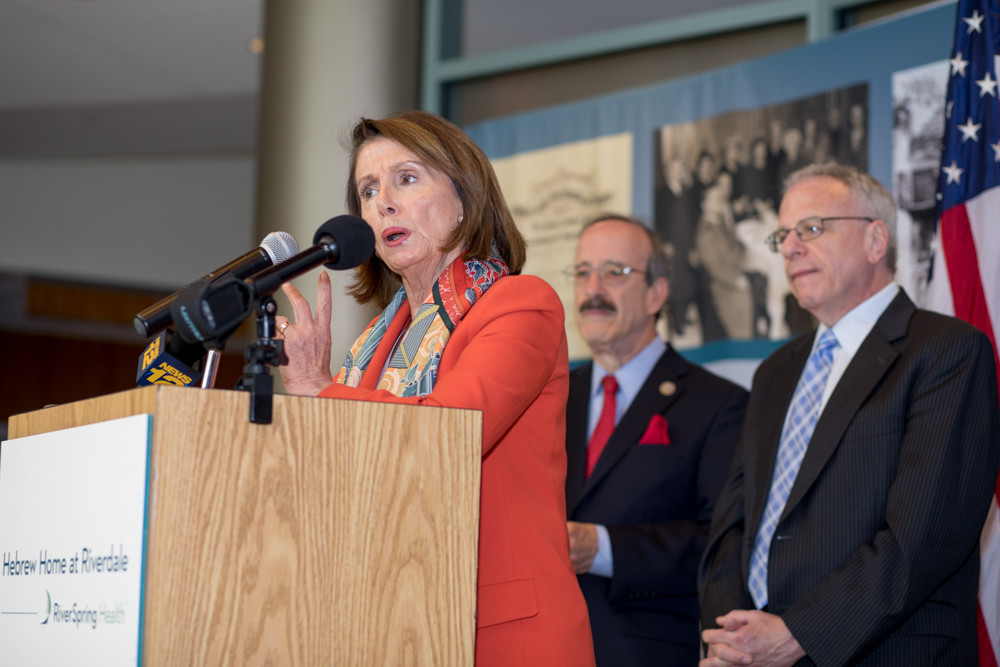 Former House Speaker Nancy Pelosi talks with residents of the Hebrew Home at Riverdale on Monday about the importance of health care and preventing legislative attacks against Medicare, Medicaid and the Affordable Care Act.