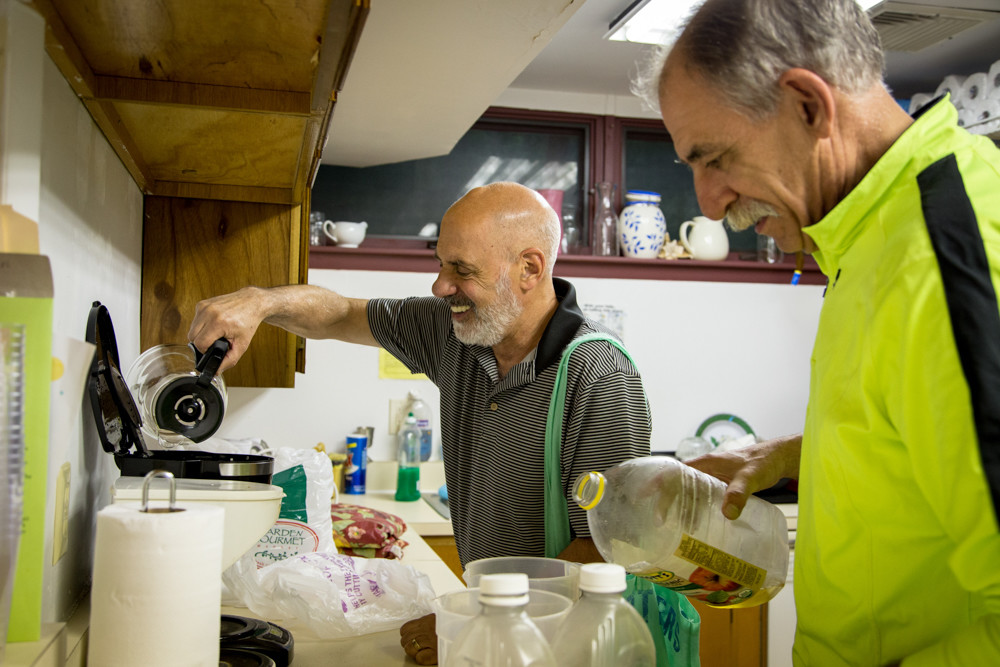 John Benfatti, the founder and coordinator of the emergency overnight men's shelter at the Riverdale-Yonkers Society for Ethical Culture, left, and Norris Ogard prepare dinner for the shelter's guests. Hebrew Institute of Riverdale plans to launch a similar shelter on Tuesday nights starting next fall.