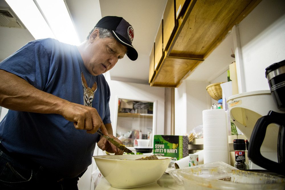 Vic Cipullo, a retired New York Police Department detective and Riverdale resident, helps prepare dinner for guests at the Riverdale-Yonkers Society for Ethical Culture's overnight men's shelter. Cipullo has volunteered at the shelter for about five years.
