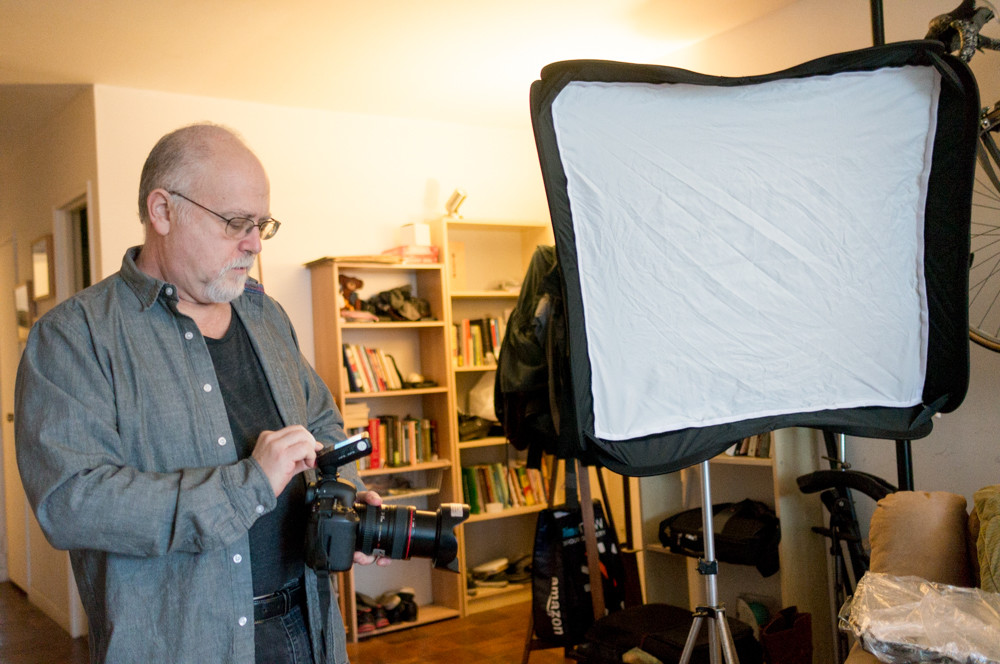 Arnie Adler adjusts the settings on his wireless trigger used to activate his camera's flash in his Spuyten Duyvil apartment. Adler is a professional freelance photographer who's worked for a variety of clients over the years.