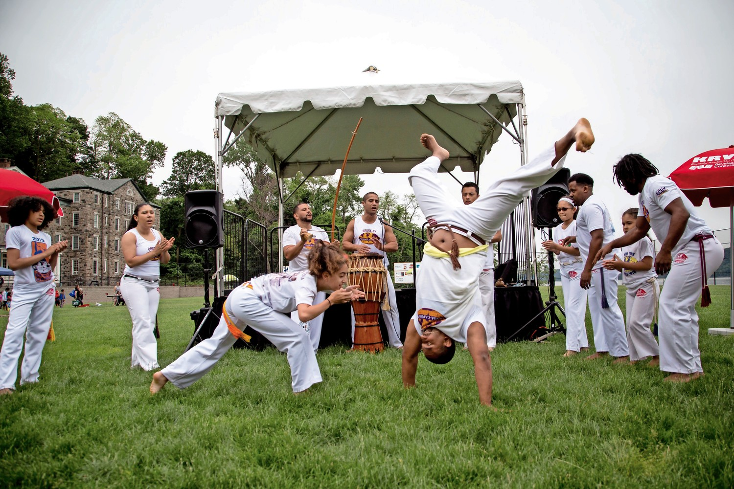 The Abada-Capoeira Bronx Cultural Arts Center performs capoeira, a Brazilian martial art that combines elements of dance, acrobatics, and self-defense techniques, during RiverFestBX.