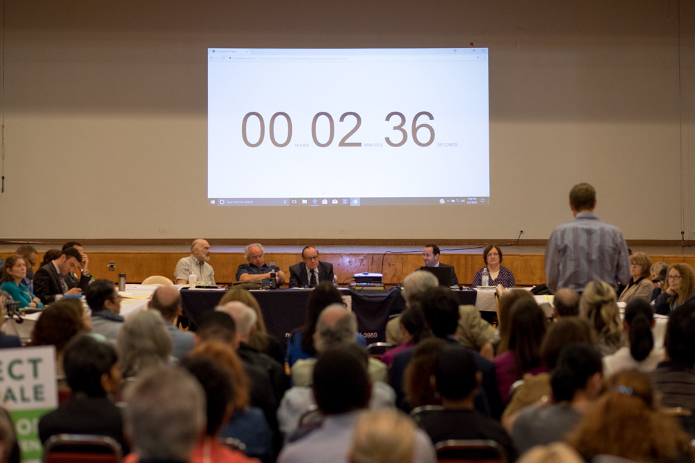 A timer ticks down precious seconds as a resident speaks about the Hebrew Home at Riverdale's controversial expansion plans during Community Board 8's land use committee meeting June 7.