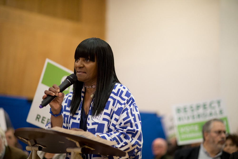 Cynthia Armstrong, a resident of the Hebrew Home at Riverdale, speaks in favor of the facility's plan to build a continuing care retirement community on its North Riverdale campus during a public hearing at Community Board 8's land use committee meeting June 7.