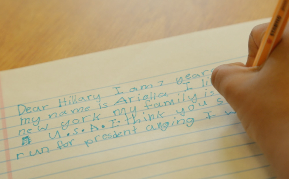 Ariella Thompson, a student at P.S. 81, writes a letter to Hillary Clinton in the short documentary film '1st Little Ladies,' which explores how Clinton influenced young girls after the 2016 presidential election.