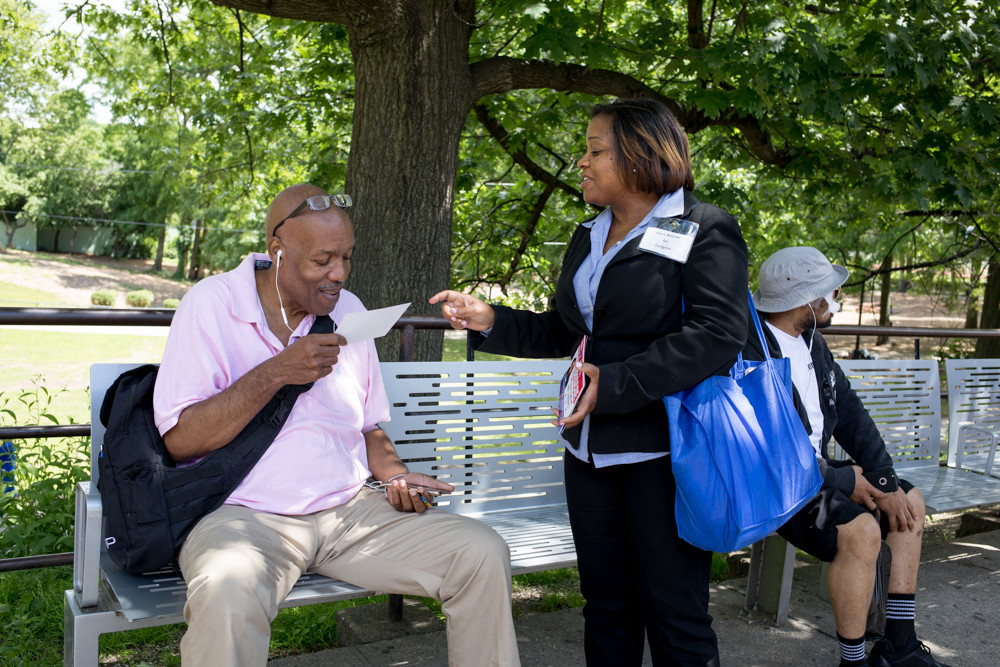 Joyce Briscoe, who's challenging U.S. Rep. Eliot Engel in next week's primary, hands out campaign literature to Rockland County resident Patrick Johnson on Broadway near West 242nd Street. Engel, Johnson said, 'has been around for an extremely long time. Give some young people a chance. Fresh blood is a good thing.'