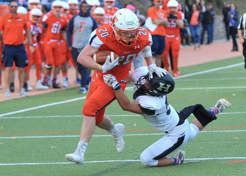 Josh Godosky, shown here running over an opposing tackler, will be taking his football — and classroom — talents to the distinguished University of Chicago.
