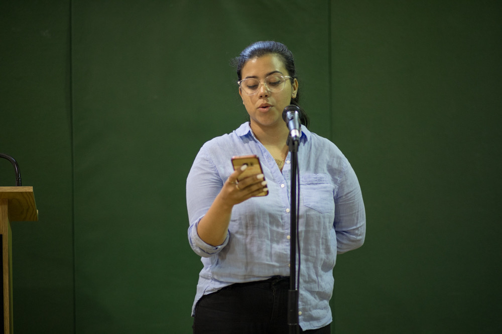 Second-place winner Fladi Nerys performs a poem about her father during the open mic portion of a poetry slam at the Kingsbridge Heights Community Center. Later in the event, Nerys decided to enter the slam.