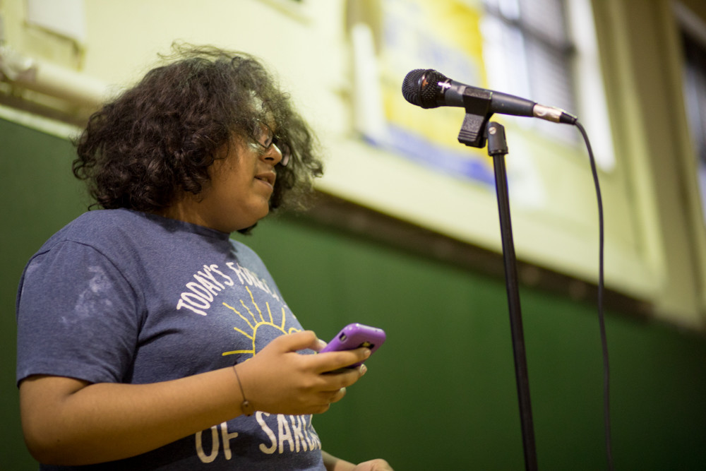 Third-place winner Dante Diaz performs a poem from the perspective of a fetus being aborted during a poetry slam at the Kingsbridge Heights Community Center.